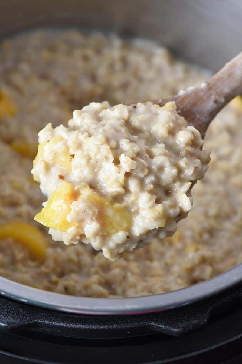wooden spoonful of peaches and cream Instant Pot oatmeal