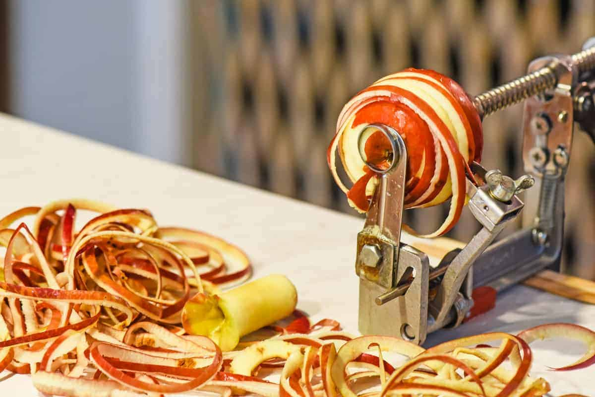 peeling and coring apples for apple butter with a clamping Johnny apple peeler