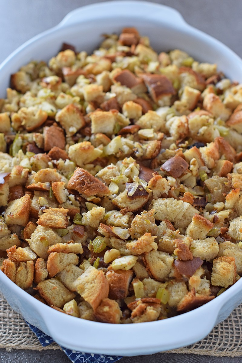 Make a classic Thanksgiving side dish with this old-fashioned homemade recipe for Apple Walnut Bread Stuffing. Delicious stuffing recipe that's also easy to make!