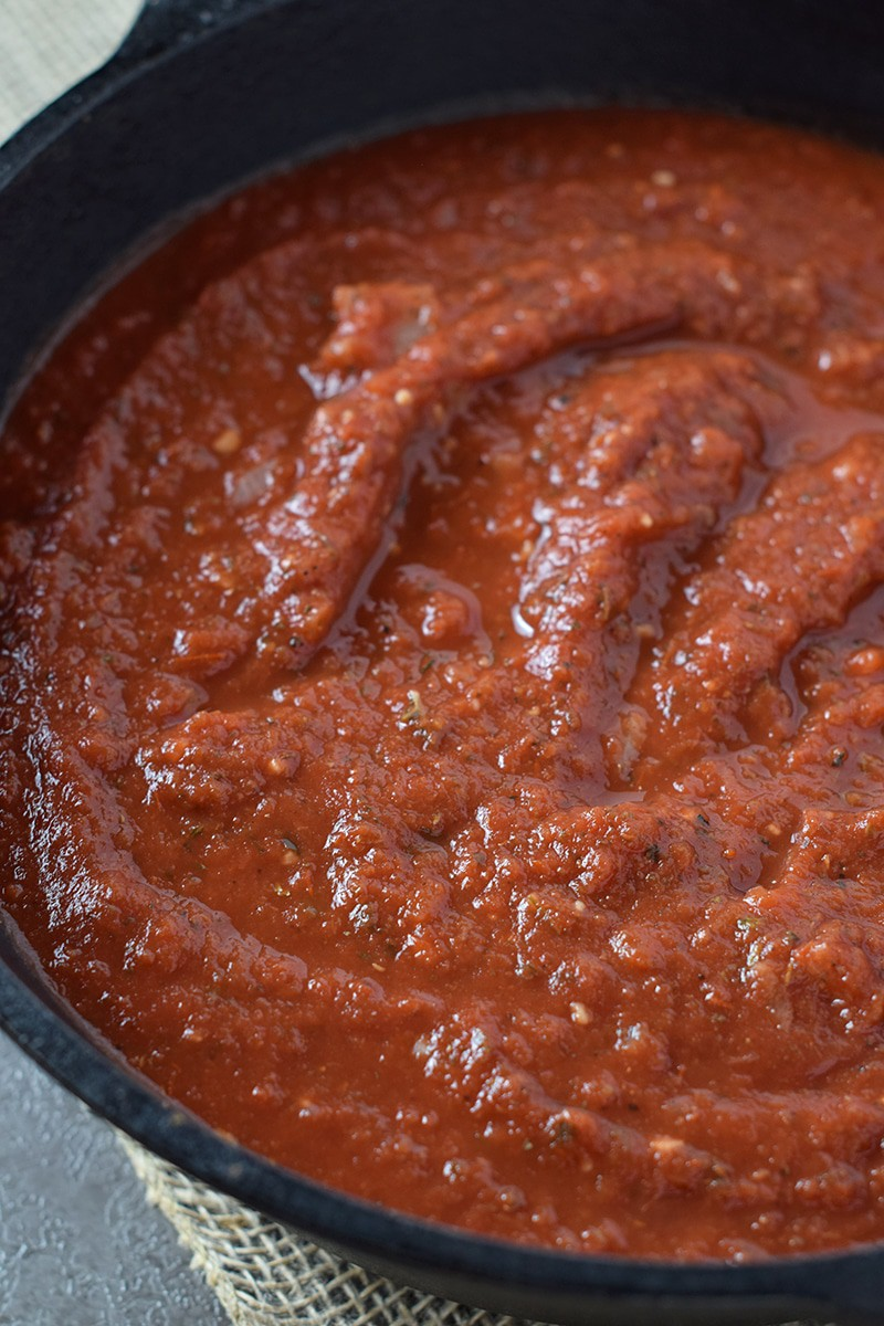 Easy Homemade Pasta Sauce perfect for your favorite pasta dishes. Make ahead and freeze for quick and easy weeknight meals.