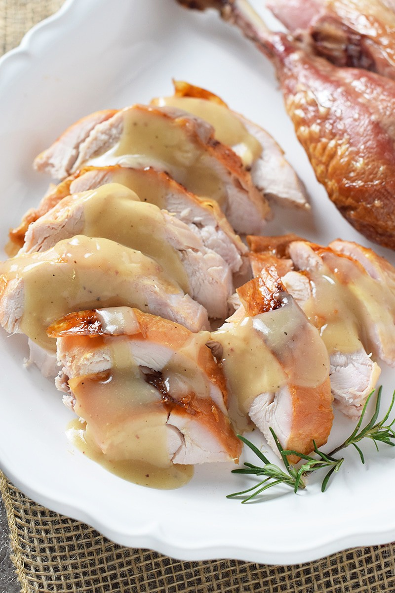 How to brine and roast a deliciously moist turkey that's perfect for family meals and holiday dinners like Thanksgiving. Maple Bourbon Brined Roasted Turkey is so full of flavor!