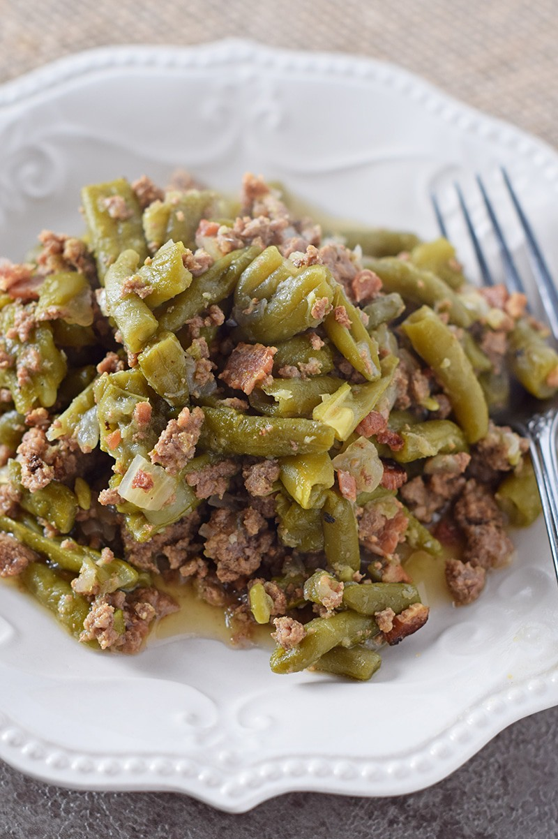 Serve up a helping of Instant Pot Southern Green Beans for Thanksgiving or a weeknight meal. Incredible flavor, cooked with bacon and ground beef. So delicious!