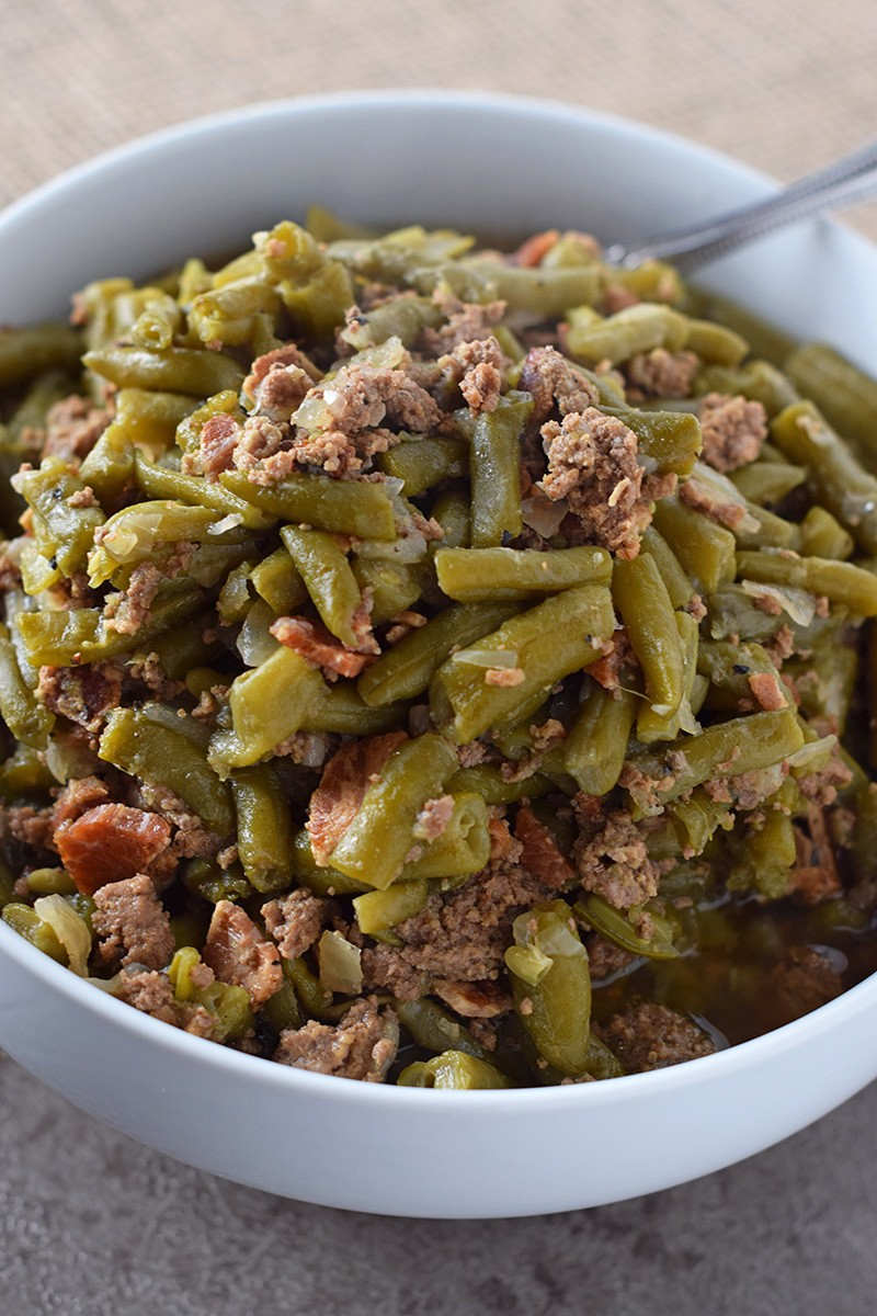 Make Southern Green Beans in the Instant Pot. Pressure cooked to perfection. Bacon, onion, and ground beef give added flavor for a delicious side dish recipe everyone will love!