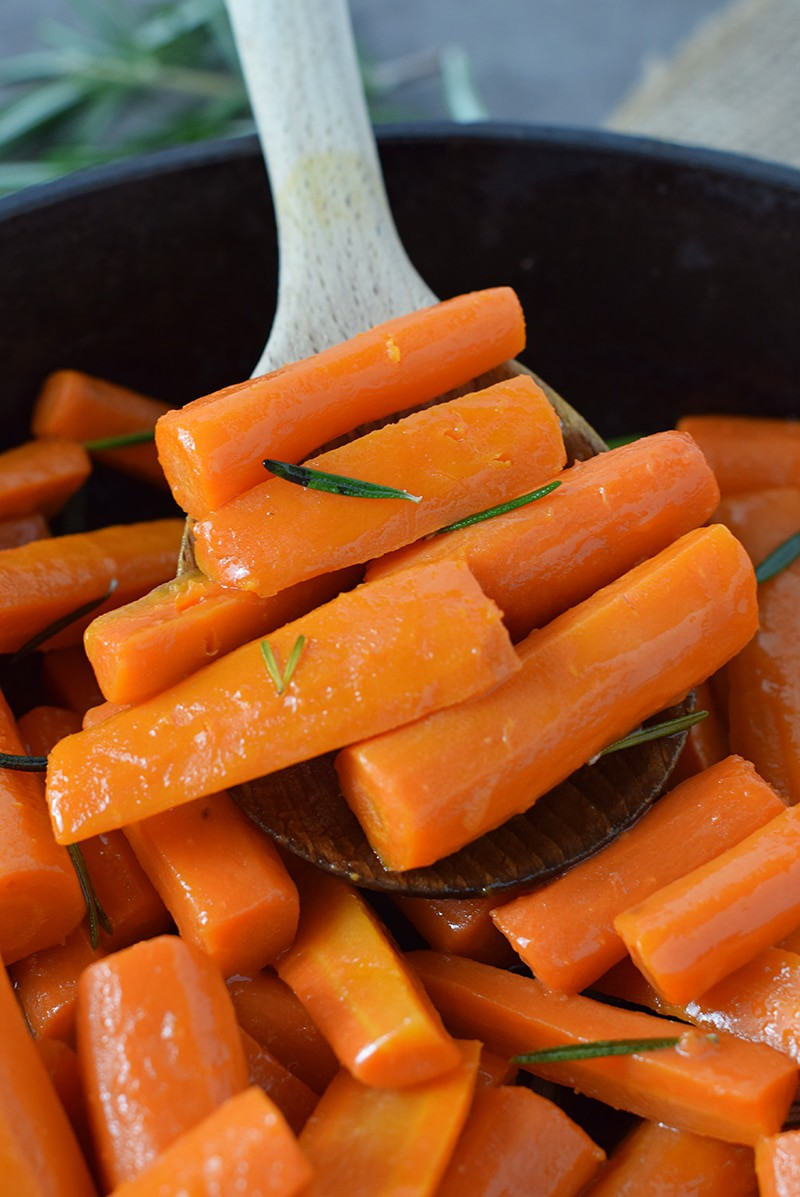 Make a delicious side dish the whole family will love, Honey Glazed Carrots. Just 4 simple ingredients, and they're so easy to make, perfect for dinner.