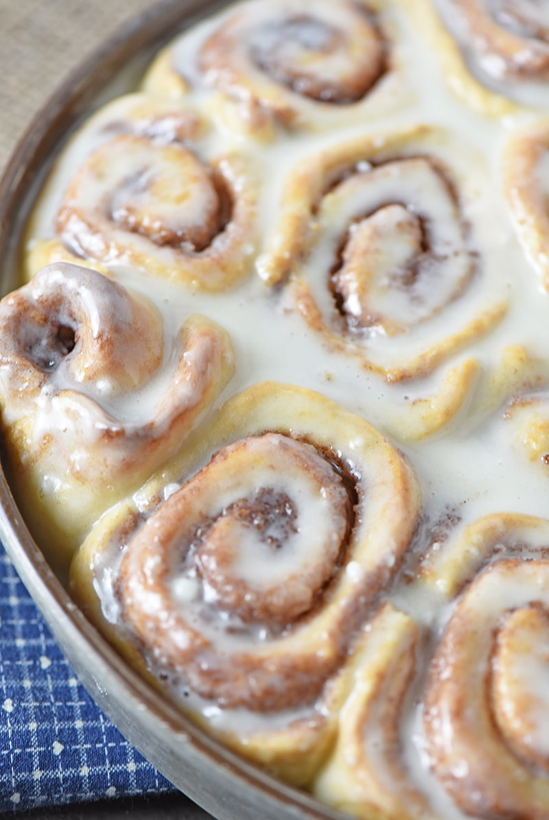 Brush a simple powdered sugar icing onto the tops of warm Biscuit Cinnamon Rolls for a warm, ooey gooey, homemade breakfast treat your family or guests will love.