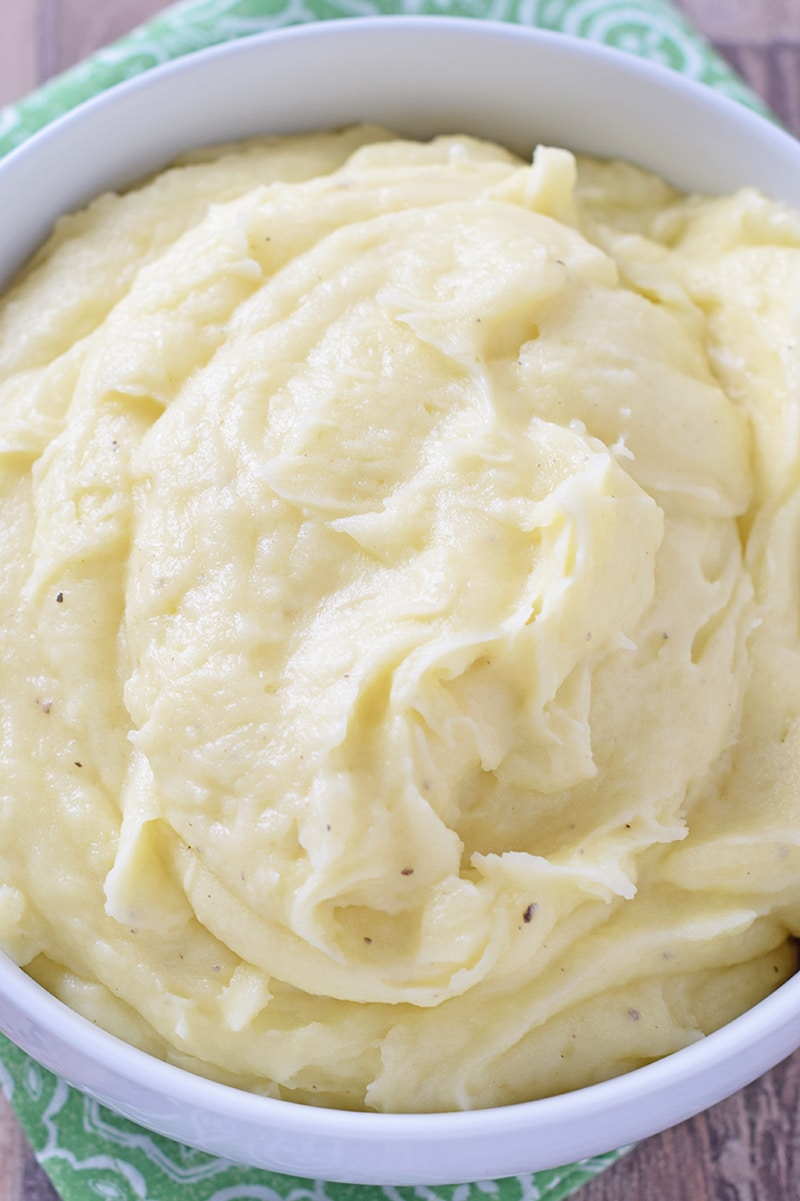Creamy Mashed Potatoes are a delicious side with weeknight meals or special holiday dinners. They're the quintessential side dish recipe to pair with turkey, ham, roast, chicken, and all the fixings!