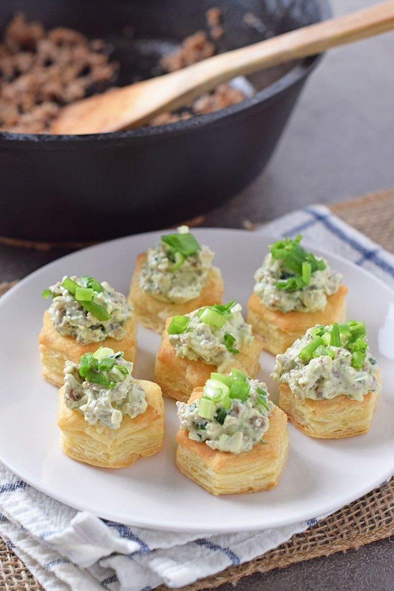Maple Sausage Stuffed Pastry Bites are so easy to make. They're the ultimate appetizer and finger food idea for holiday parties and family get togethers.