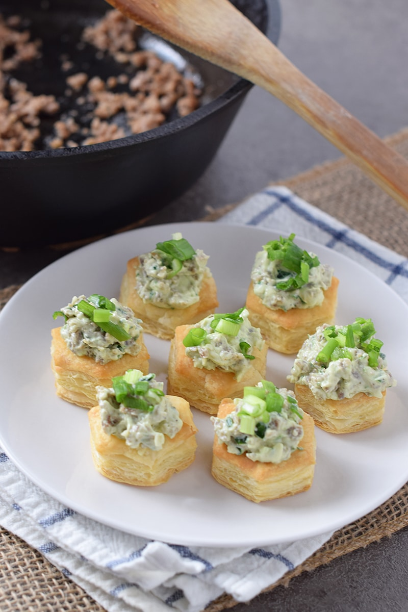 Maple Sausage Stuffed Pastry Bites, made with puff pastry cups, cream cheese, spinach, and Ranch dressing mix. They're so scrumptious, all your holiday party guests will love them!