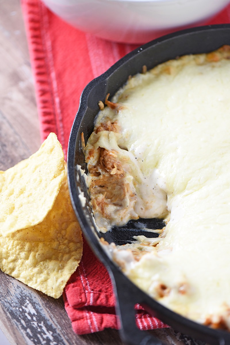 Make a Creamy BBQ Chicken Dip to pair with tortilla chips, crackers, and raw vegetables. Delicious party appetizer and easy snack idea!
