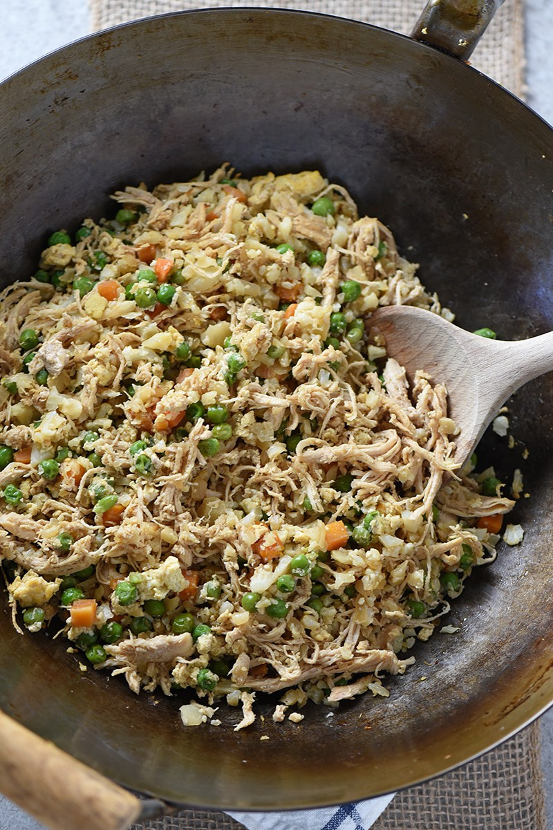 Cauliflower Chicken Fried Rice you can make at home. Skip the takeout and choose a healthier option. Easy recipe your family will love!