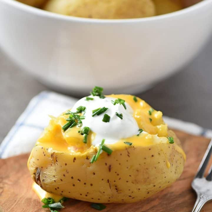 Instant Pot Baked Potatoes are pressure cooked in less than 10 minutes. Easy to make, they're a delicious dinner side dish the whole family will love!