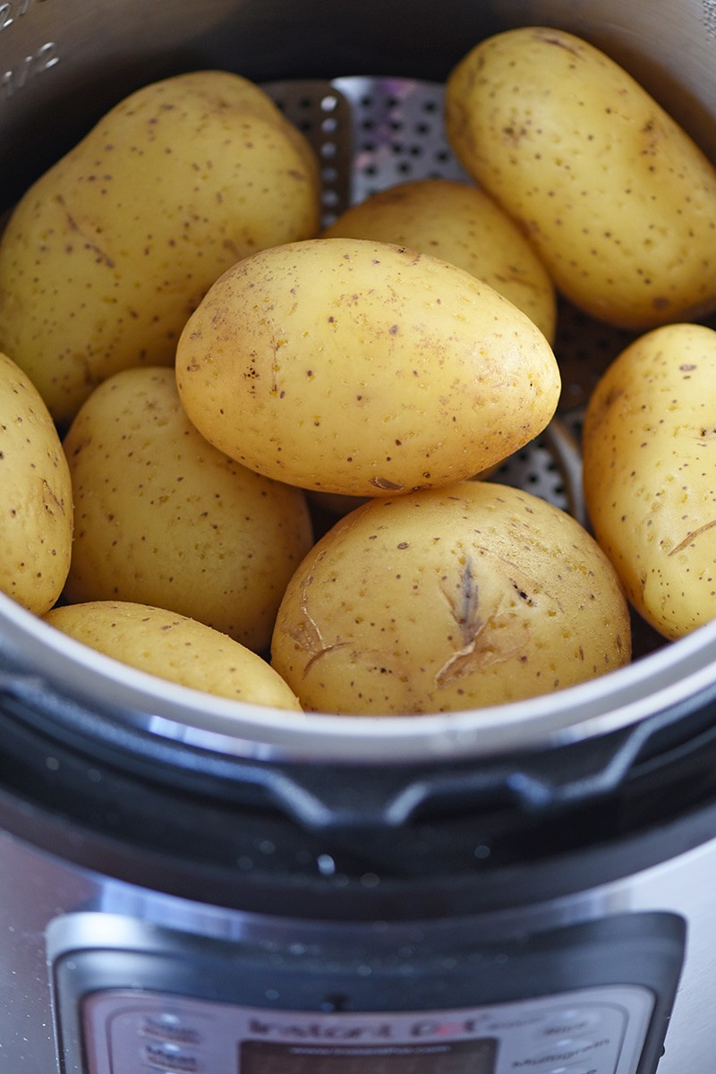 Baked Potatoes are so quick and easy to make in the Instant Pot. And Instant Pot Baked Potatoes come out cooked to perfection, so tender, moist, and delicious.