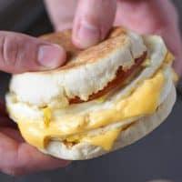 holding a homemade McDonald's Egg McMuffin breakfast sandwich