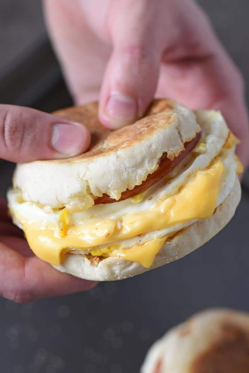 holding a homemade McDonald's Egg McMuffin breakfast sandwich