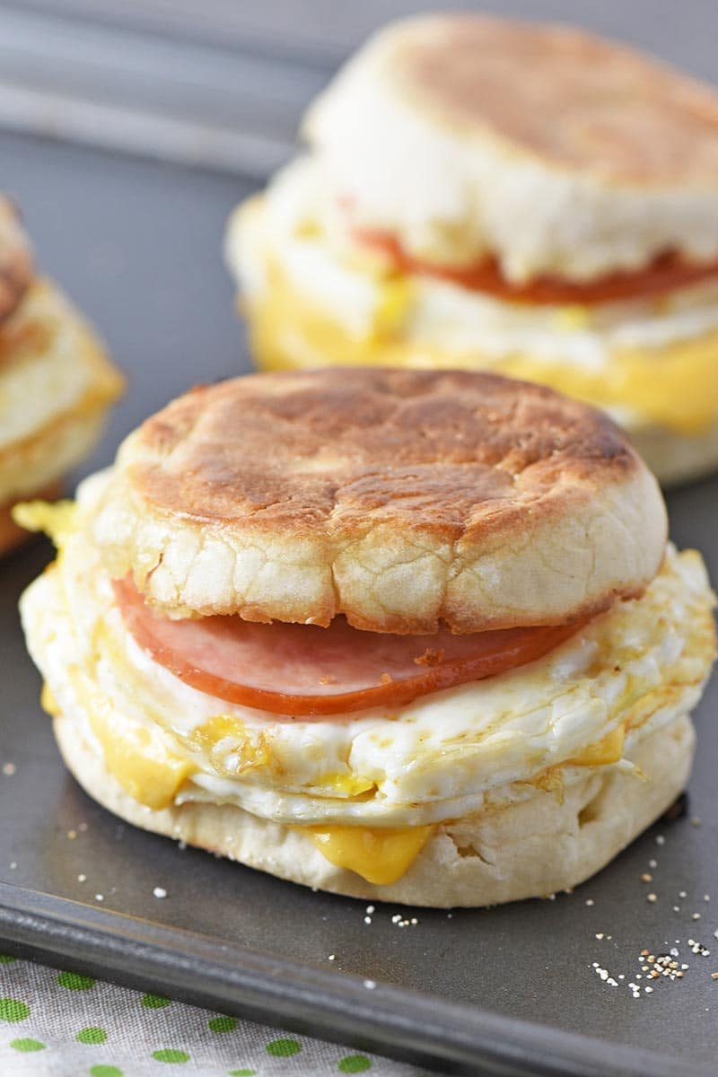a delicious English McMuffin made with Canadian bacon, eggs, and cheese on an English muffin, sitting on a baking sheet