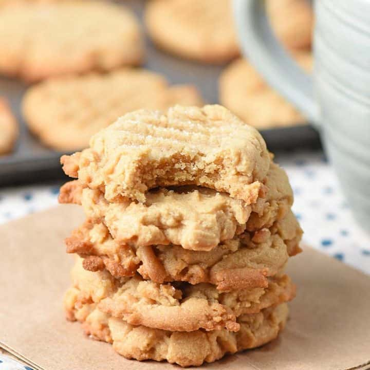 Chewy peanut butter cookies stack with a bite taken out