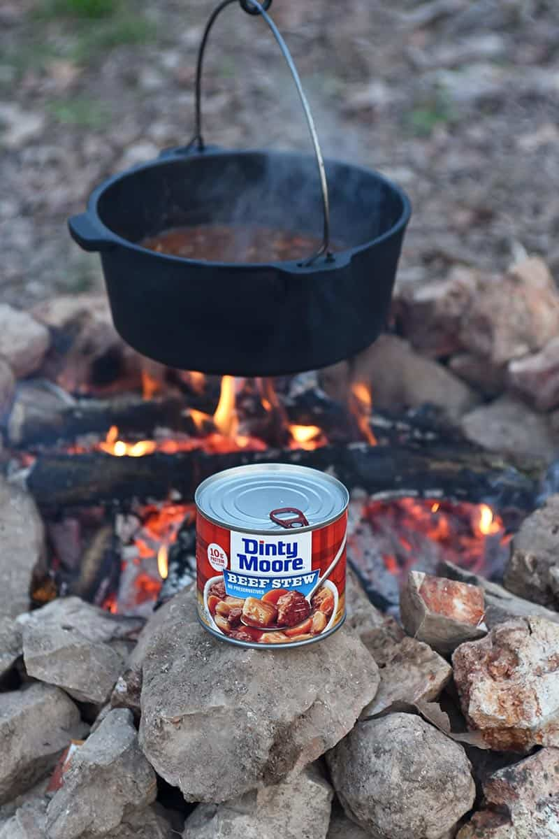 cooking DINTY MOORE® Beef Stew in a Dutch oven over the fire