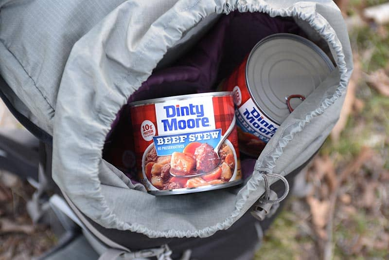 delicious camping food like DINTY MOORE® Beef Stew in a backpack
