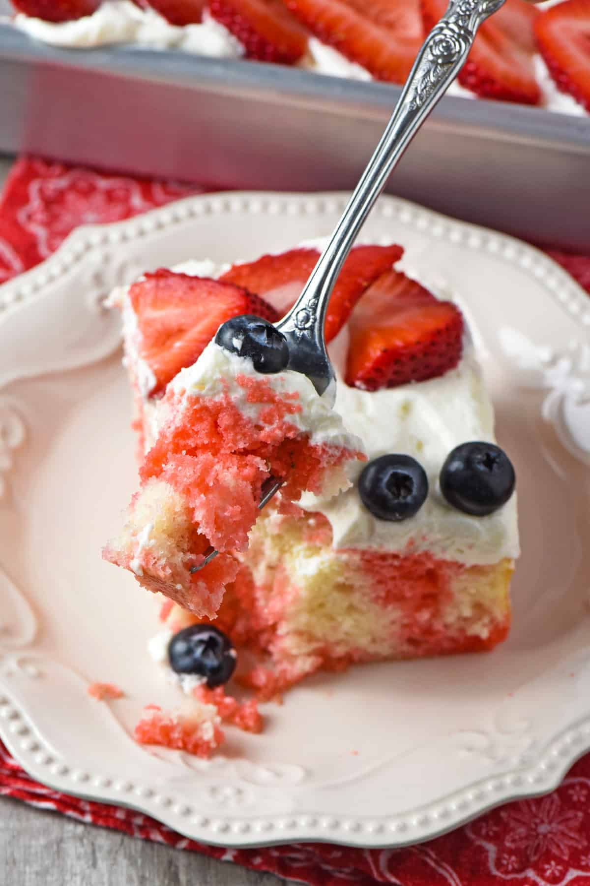 slice and bite of 4th of July cake on fork
