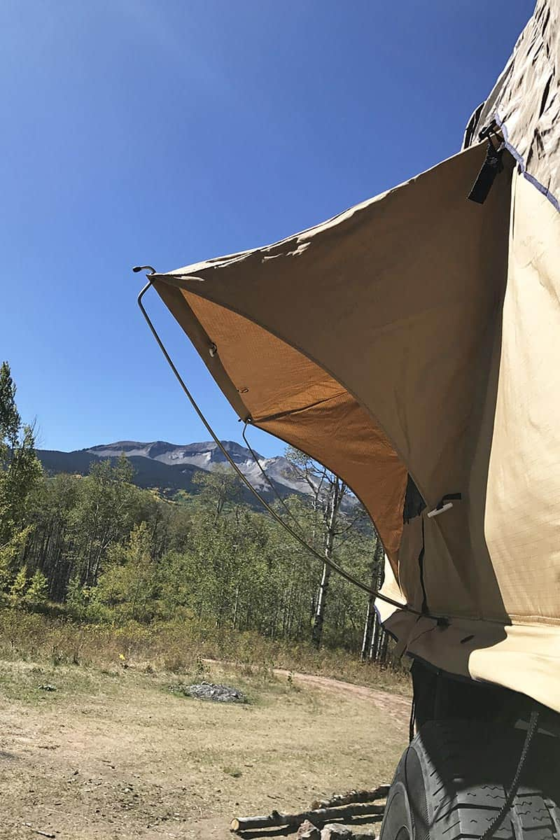 rooftop tent camping in Colorado with camping gear for dispersed camping