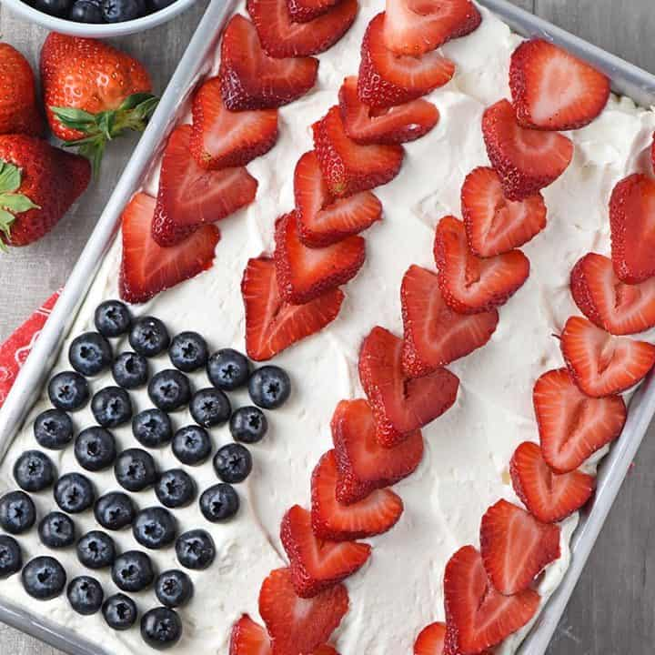 Strawberry Jello cake made into an American flag with fresh strawberries and blueberries