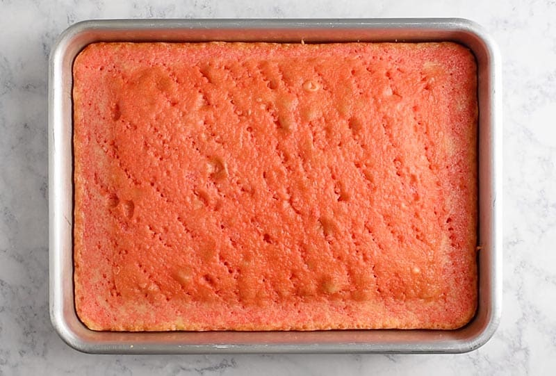 "strawberry Jello cake in a 13""x9"" cake pan"