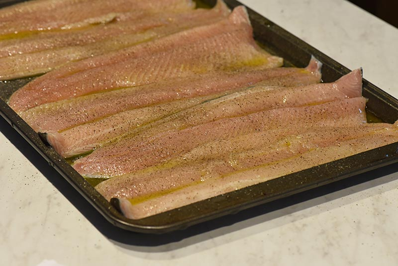 grill fish with a coating of olive oil and salt and pepper seasoning