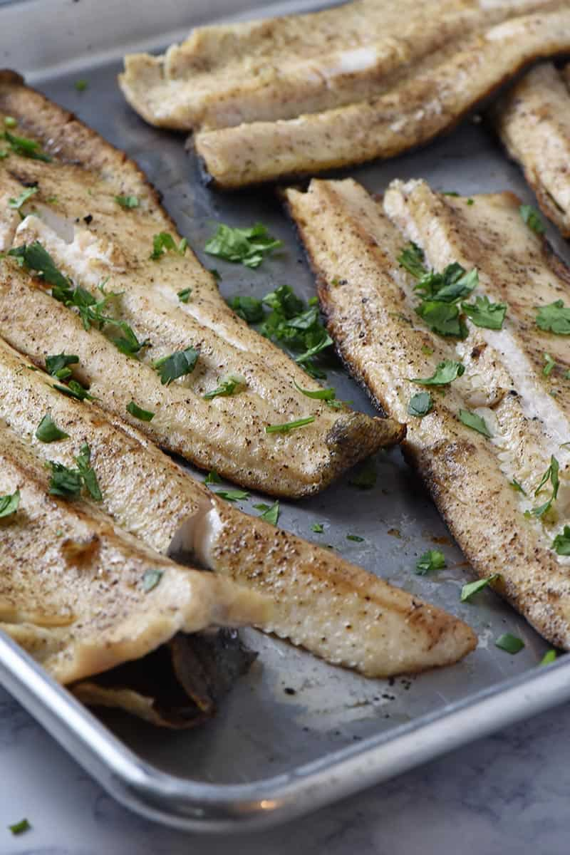 grilled fish fillets recipe, cooked ad placed on a baking sheet