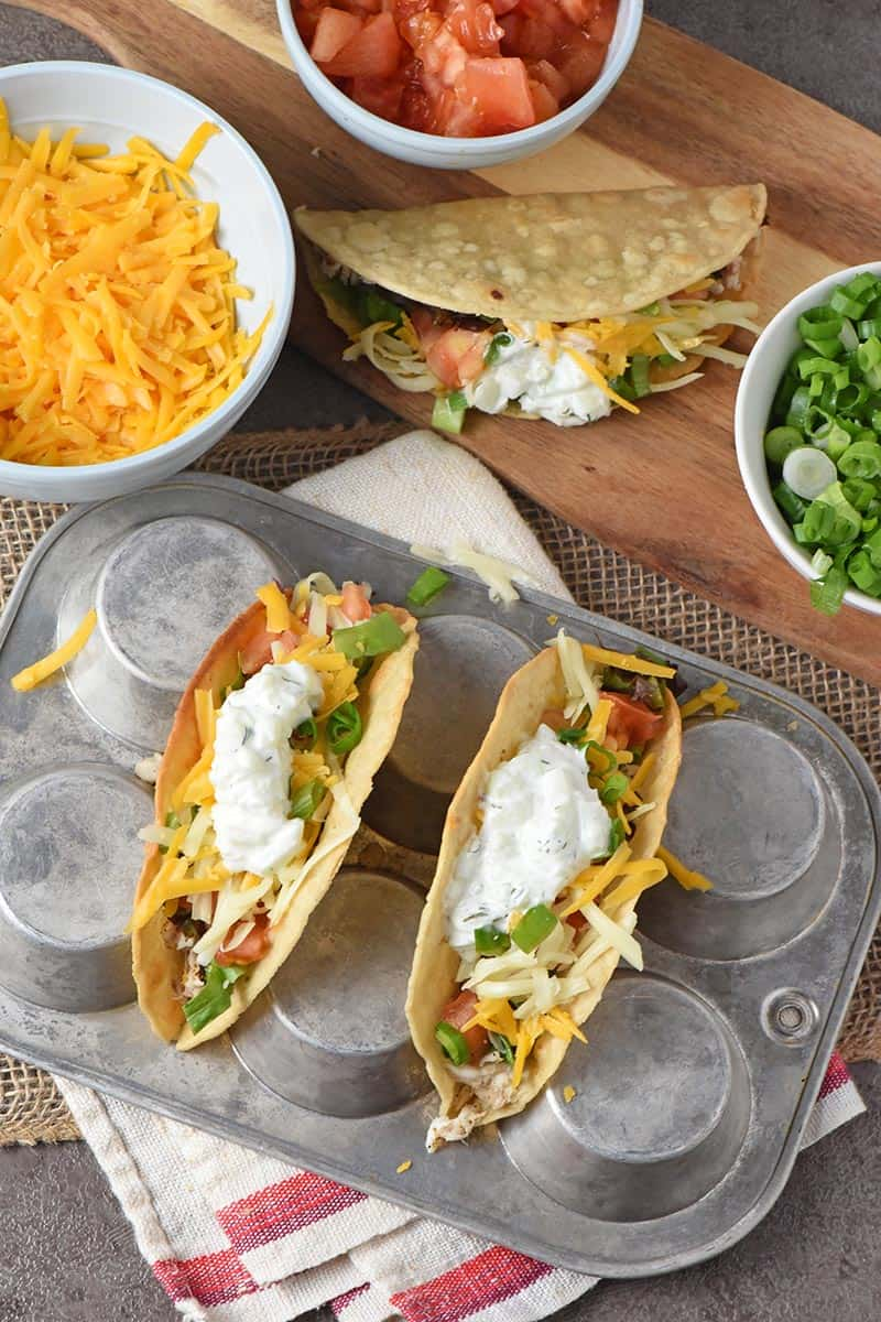 fish tacos recipe ingredients, including cheese, tomatoes, and green onions