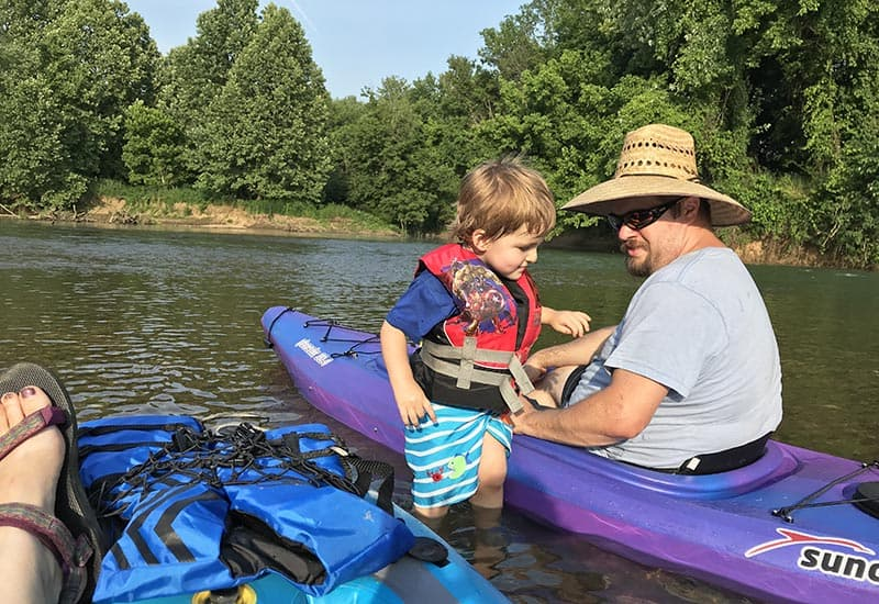 exploring the creek while kayaking with kids