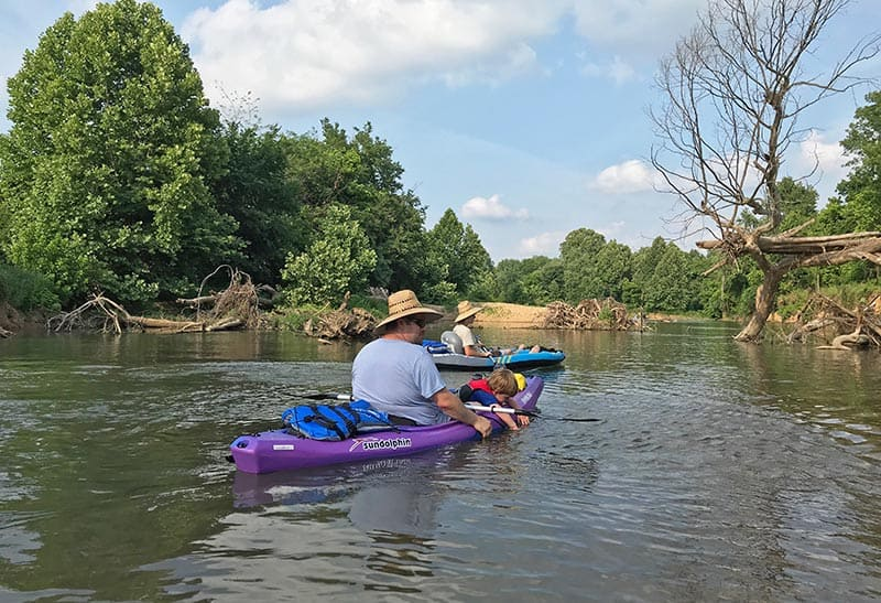family kayaking on Illinois River near Siloam Springs, Arkansas