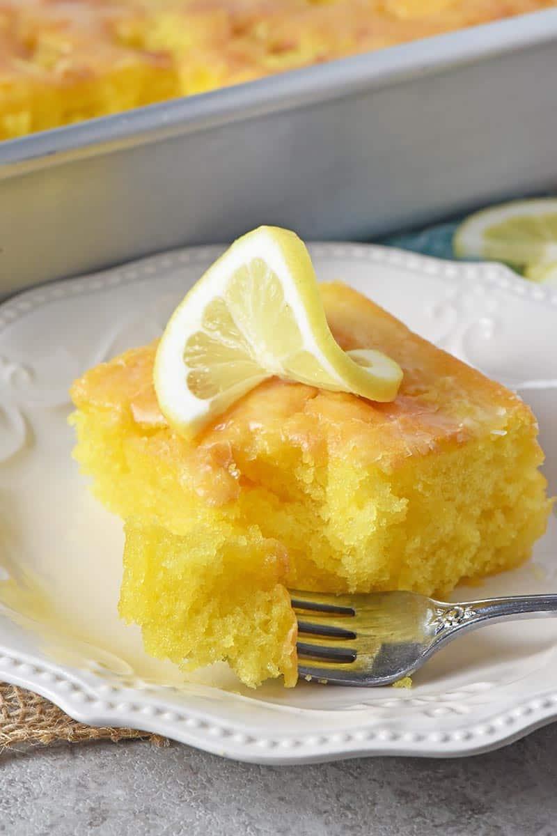 slice of lemon cake with bite on fork