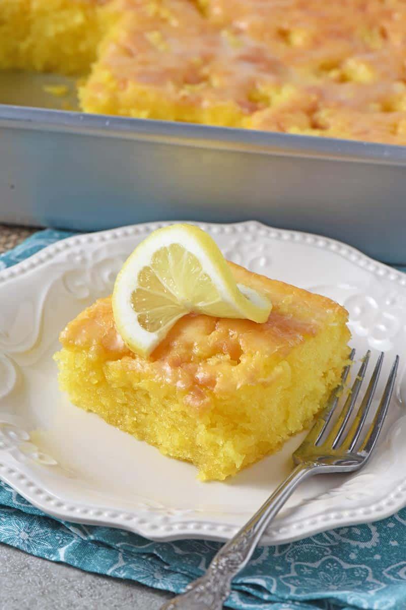 slice of easy lemon cake on white plate with fork