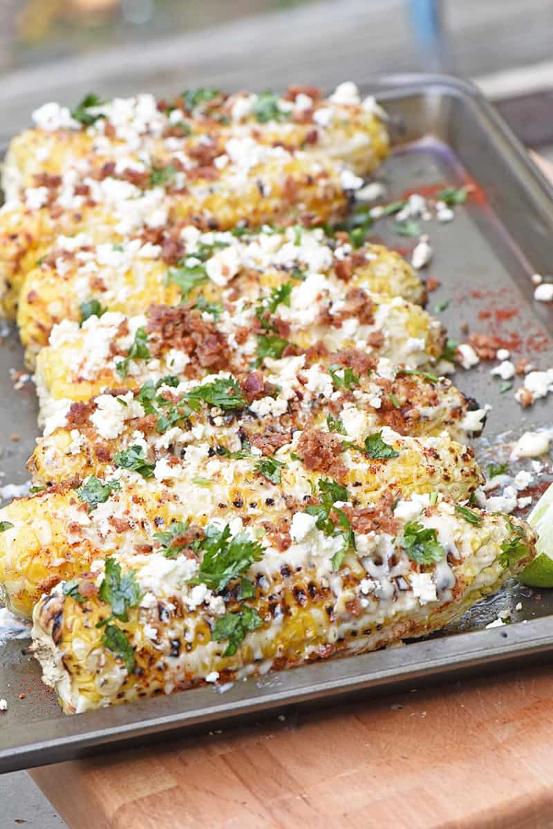 grilled Mexican corn on a baking sheet