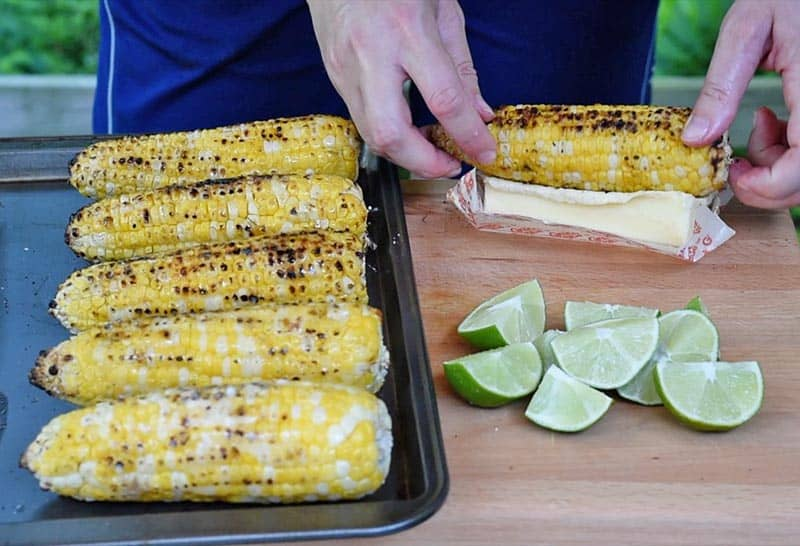 Butter ears of grilled corn on the cob for Mexican corn on the cob recipe