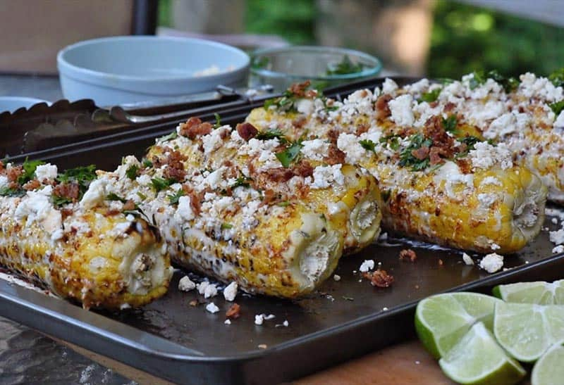 crumbled bacon on Mexican corn