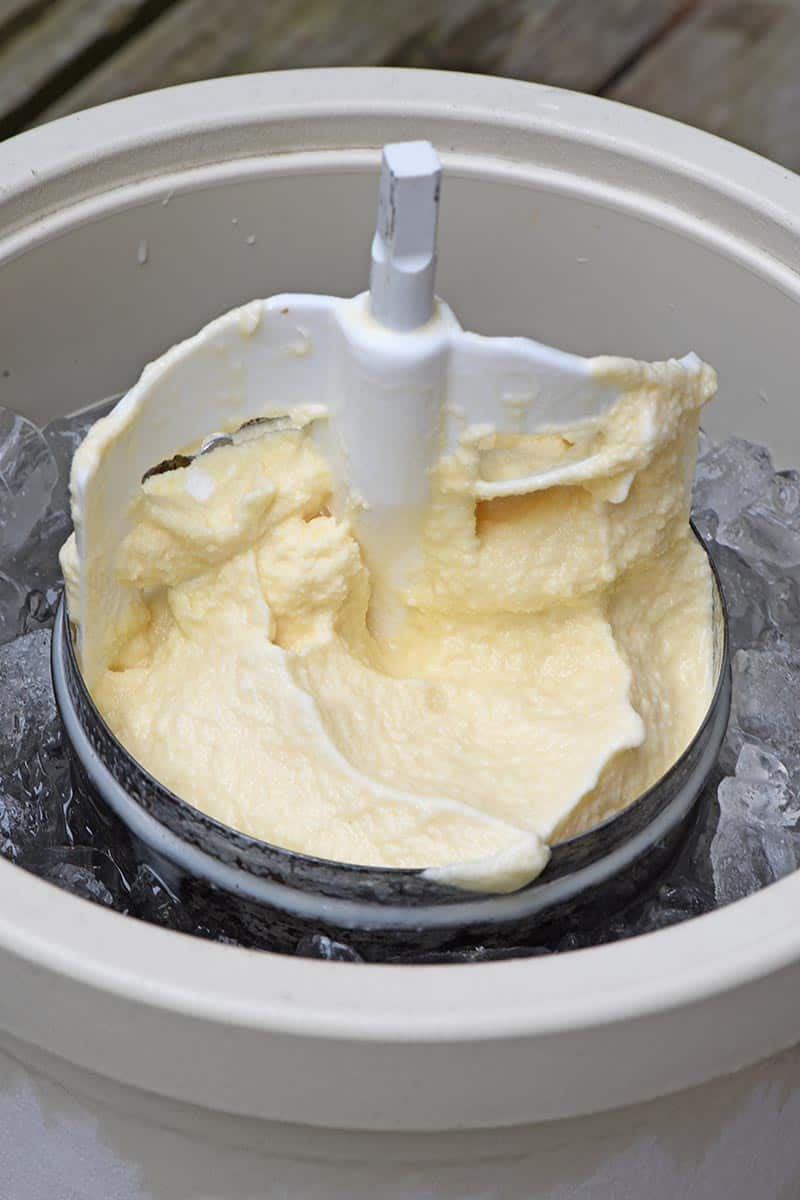 churning paddle in canister of homemade vanilla ice cream