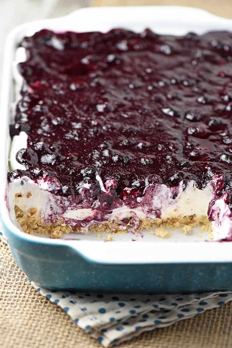 dreamy no bake blueberry dessert in turquoise baking dish