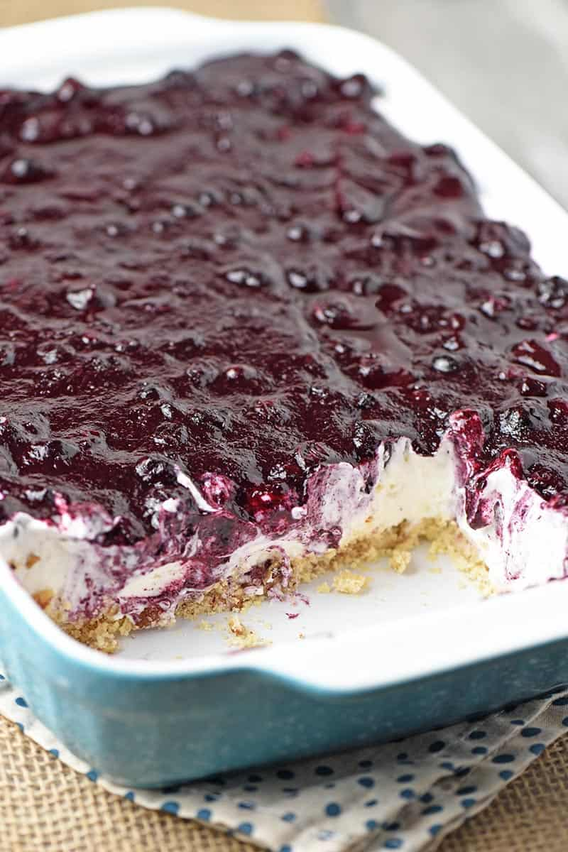 easy blueberry dessert made in a blue baking dish