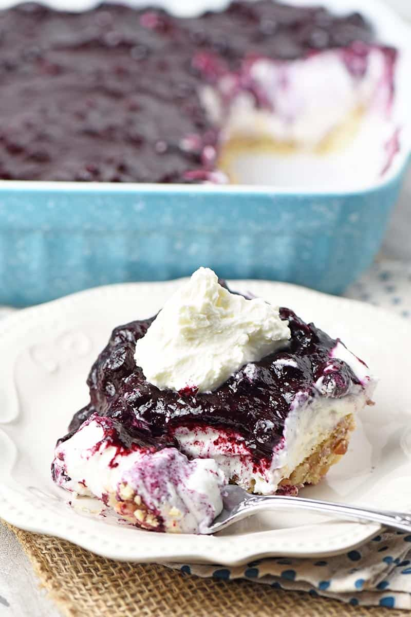 slice of creamy no bake blueberry dessert on white plate