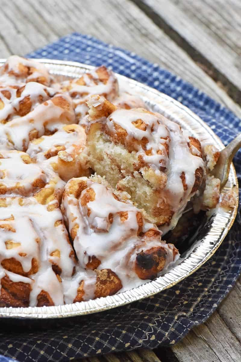 serving cinnamon rolls while camping in the great outdoors