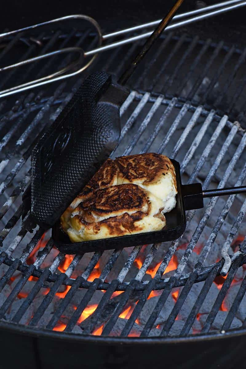 grilling cinnamon rolls in a pie iron