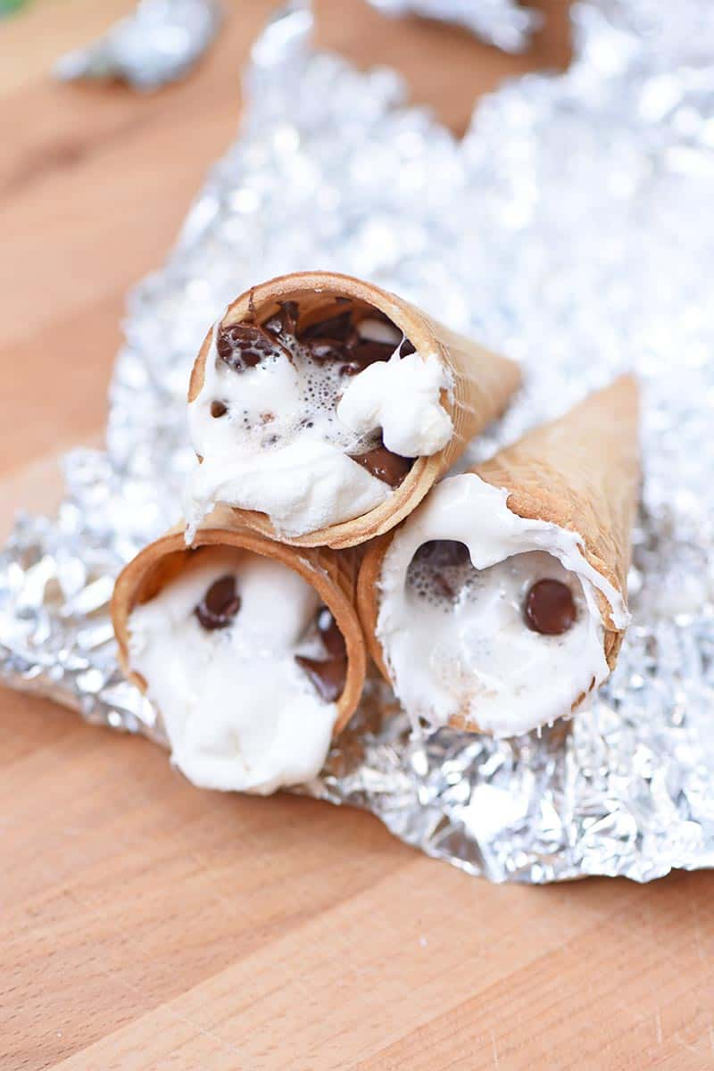 melted sugar cone s'mores sitting on foil cooling before eating