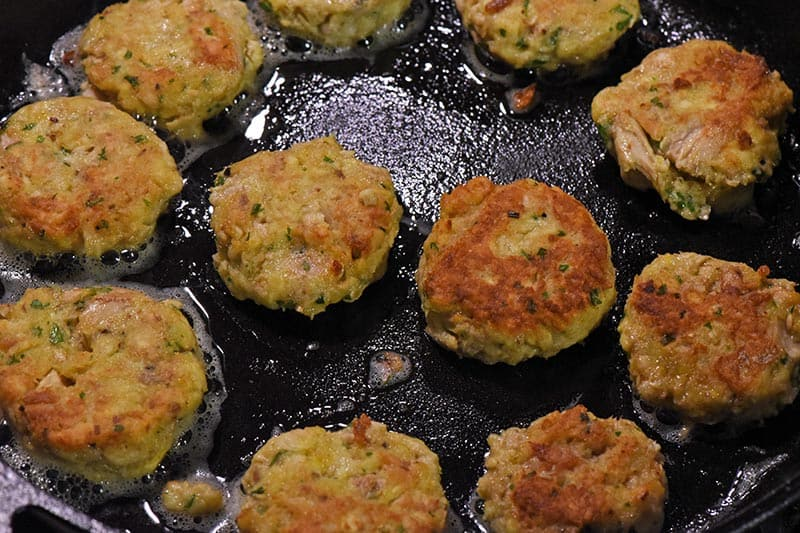 fried salmon patties in cast iron skillet