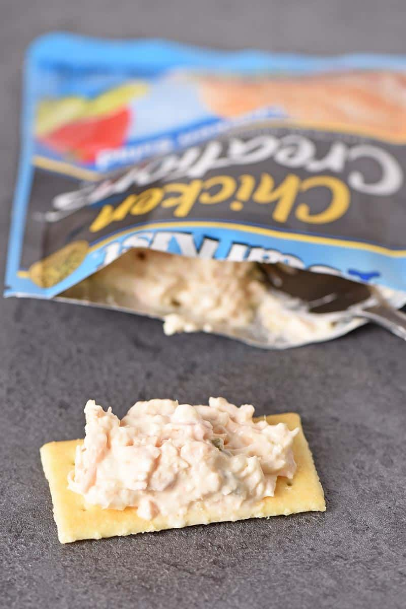 StarKist Chicken Creations Chicken Salad on a cracker, eating right out of the pouch