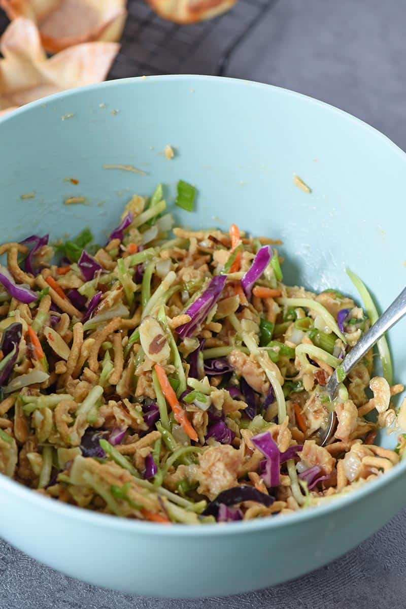 easy Asian salad recipe in blue mixing bowl