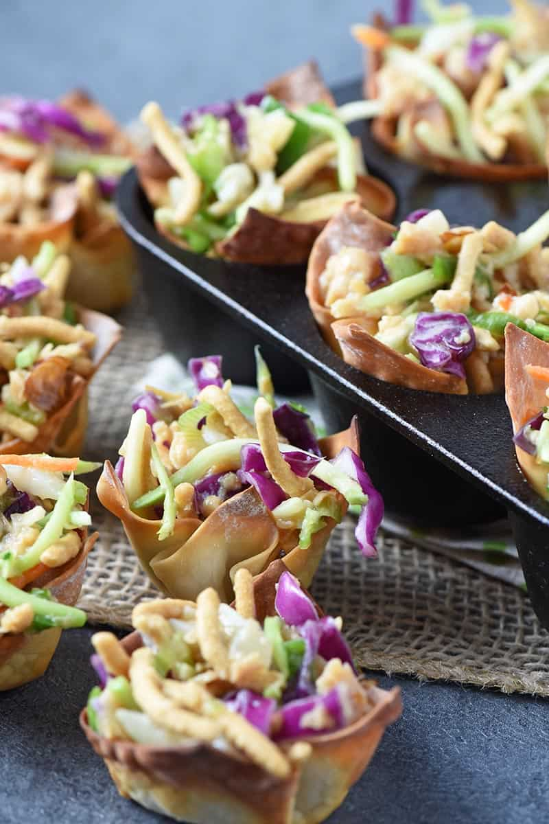 bite sized wonton appetizers filled with Asian chicken salad