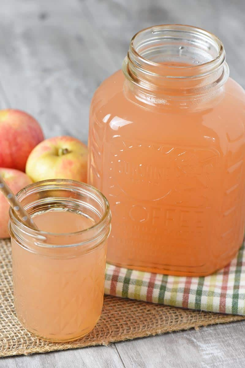 fresh apple juice in Sunshine Coffee jar and jelly jar with paper straw