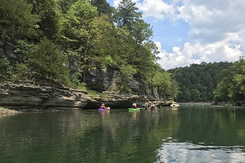 kayakers in a cove in Hobbs State Park on Beaver Lake