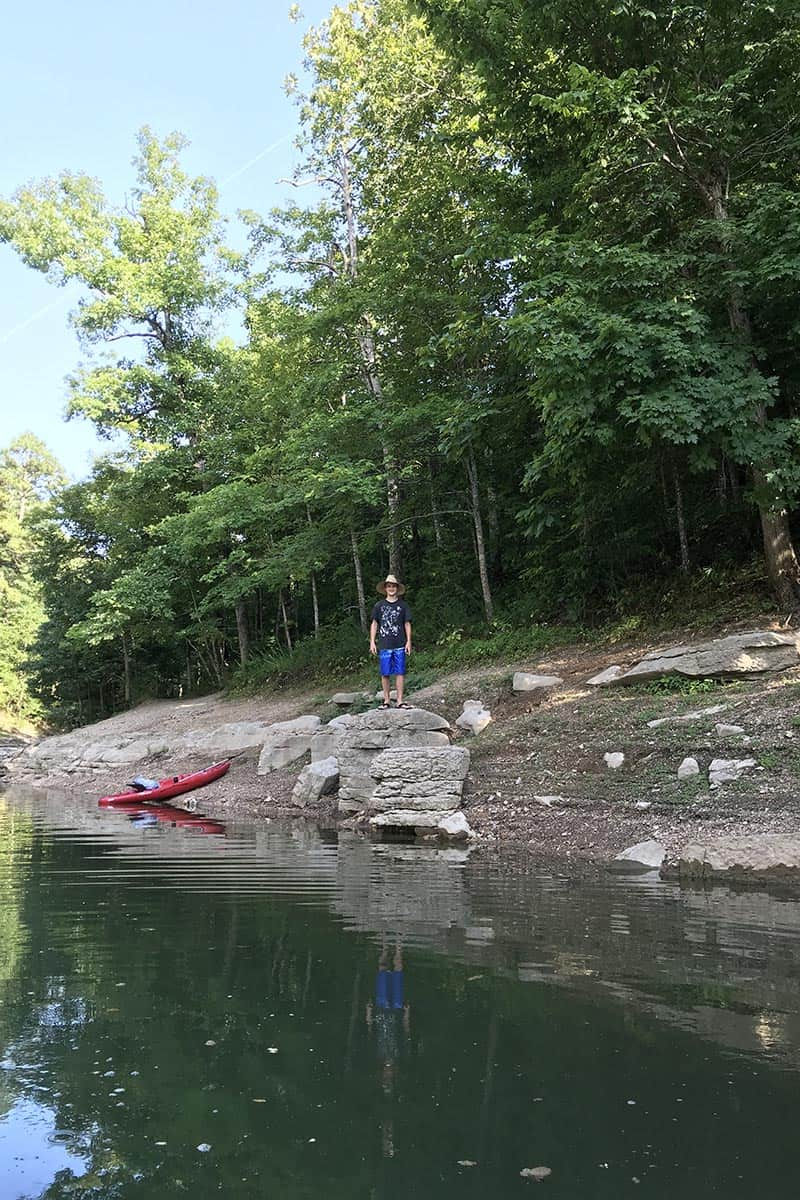 kayaker exploring maple trees in Hobbs State Park